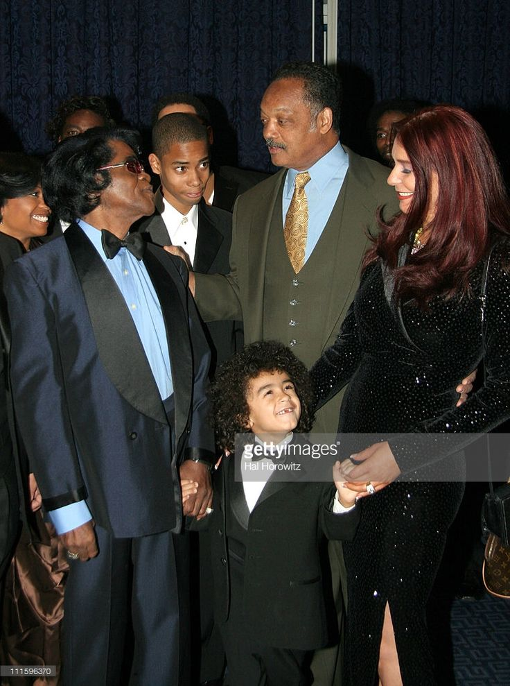 James Brown, Jessie Jackson, James Brown's son James Jr. and wife Tomi Rae Hynie