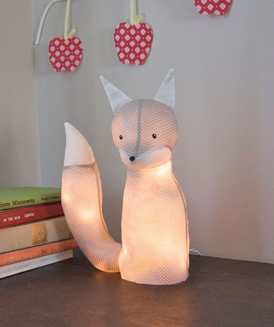 NO WAY! DIY Fox Lamp. Just sew, stuff, paint the fabric with fabric stiffener, unstuff then run some Christmas lights into the hardened shell. Brilliant and cheap!