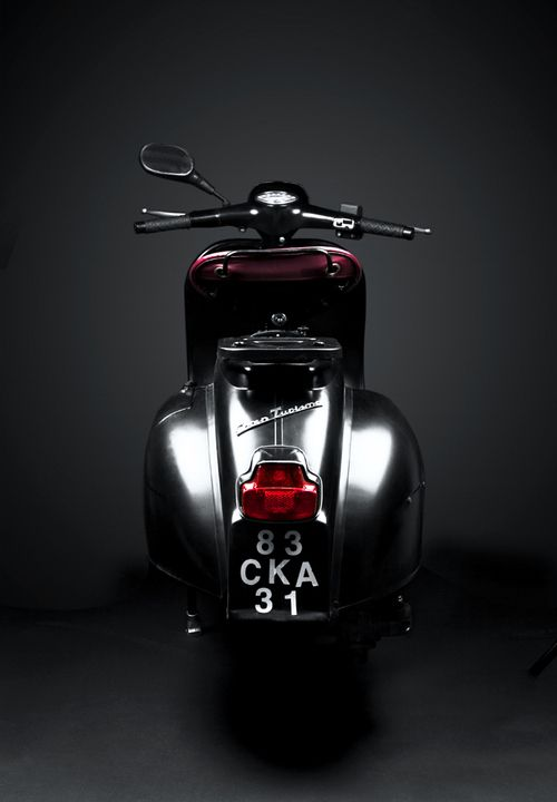 I love scooters - especially Vespas. And this one just happens to be beautifully lit and photographed too. (I like that it only has one rearview mirror - but wouldn't two be better?)