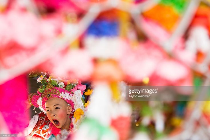 A Tai Yai boy waits for a ceremony to begin during the Poy Sang Long Festival on April 1, 2015 in Mae Hong Son, Thailand. Poy Sang Long is a Buddhist novice ordination ceremony of the Shan people or Tai Yai, an ethnic group of Shan State in Myanmar and northern Thailand. Young boys aged between 7 and 14 are ordained as novices to learn the Buddhist doctrines.
