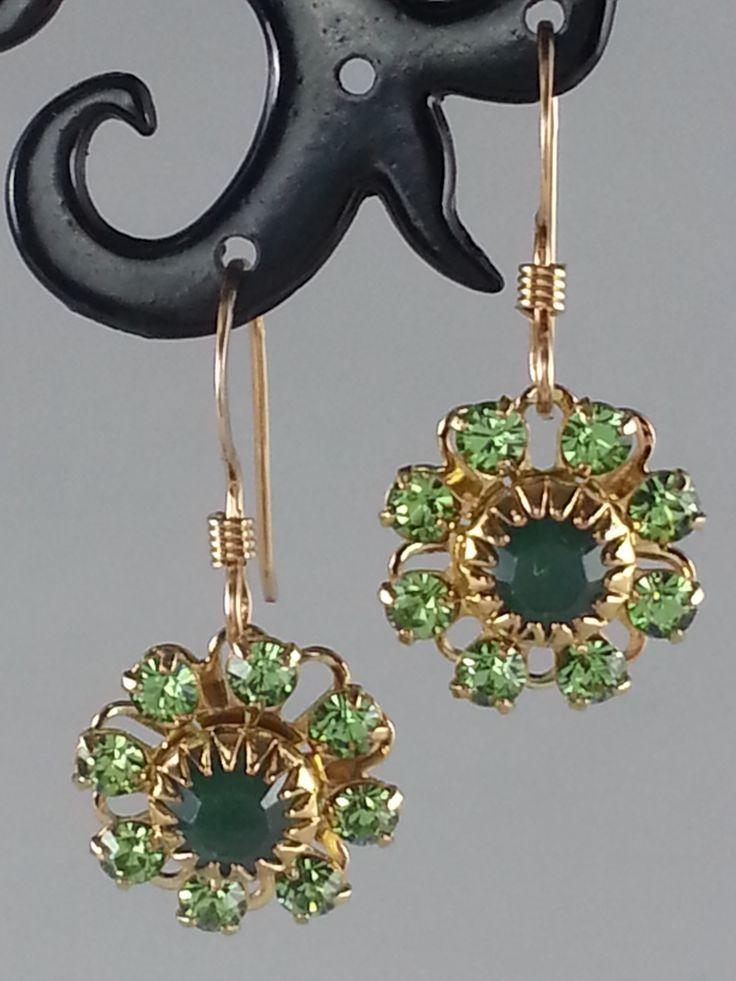 Green Swarovski crystals on gold tone earrings