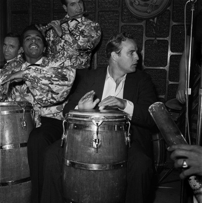 "American actor Marlon BRANDO playing drums. 1960. by Raymond Depardon  FRANCE. Paris. 8th arrondissement. ""Keur Samba"" nightclub."