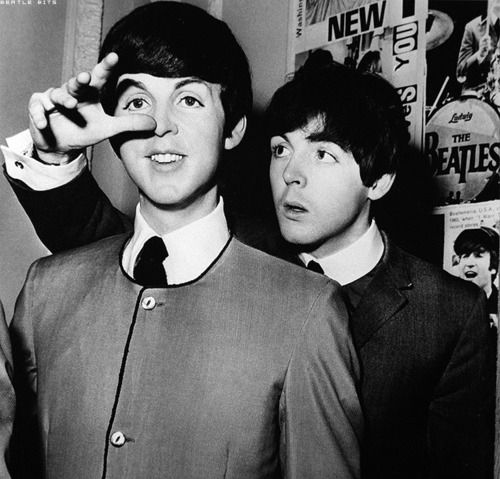 Beatle Paul McCartney takes a photo with his wax statue at Madame Tussauds Museum in London, March 28, 1964