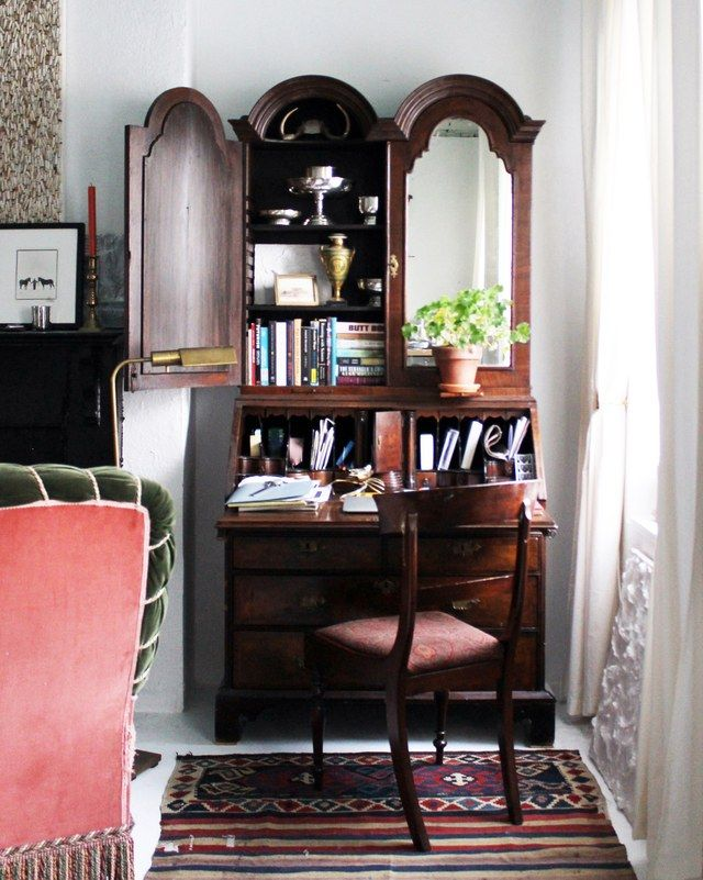 A Georgian secretary in the corner boasts mirrored cabinets that subtly reflect light around the room | archdigest.com