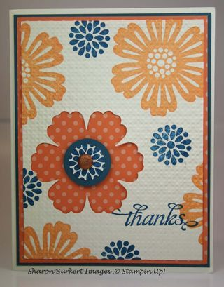 handmade card ... another version of allowver flowers with Mixed Bunch in peach and navy ... negative space punched to show orange polka do paper ... Stampin' Up!