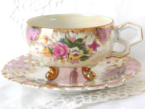 Vintage footed lusterware tea cup and saucer decorated in pink and gold on off white porcelain - teacyo