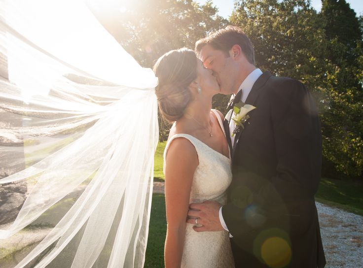 The sun shined perfectly through Morgan's veil as the bride and groom made their…