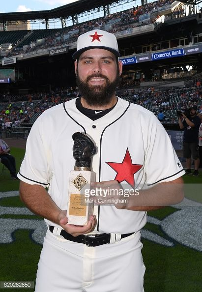 Michael Fulmer of the Detroit Tigers poses for a photo with his Larry Doby Legacy Award for American League Rookie of the Year while wearing a Detroit Stars Negro League Tribute uniform prior to game...