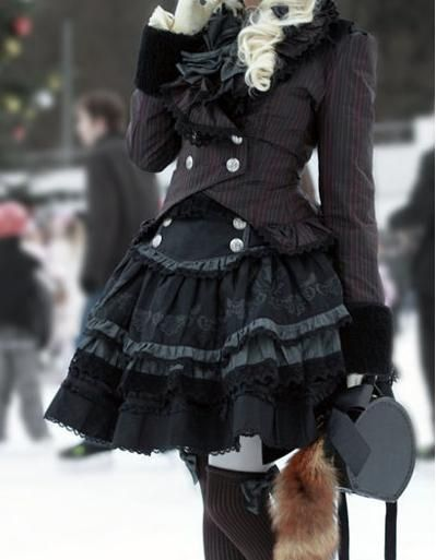 this is a gothic lolita outfit. im not a girly girl but this is adorable and i so want it.