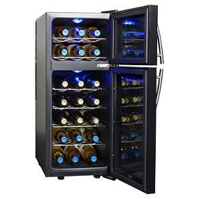 Chill your wine to the perfect temperature in the NewAir AW-210ED thermoelectric wine cooler. This dual zone cooler stores red and white wine in separate compartments, with two doors for optimal climate control. Digital thermostat controls with external display lets you easily monitor and control interior temperatures in each zone. 6 chrome shelves hold up to 21 standard sized bottles of your favorite wines, and slide out for easy accessibility. Built with a thermoelectric cooling system…