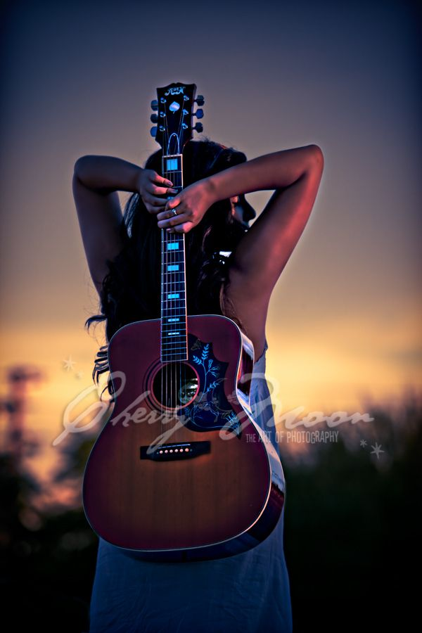 "For the love of music.  My daughter's senior pic. Check out her latest music video called ""Fourteen""  http://youtu.be/NfVQ0pRXJWs"