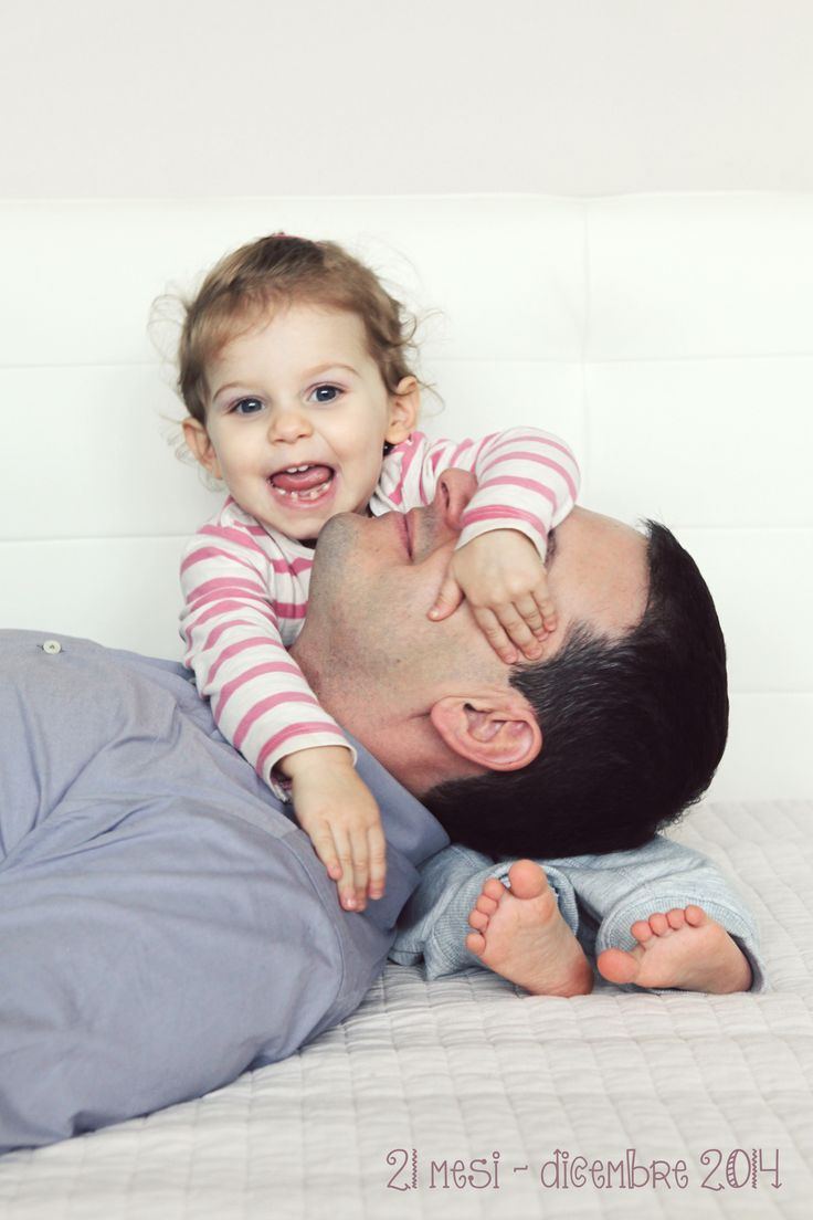 smiling little girl with her dad