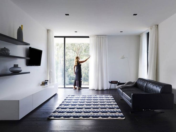 Home: Bright White Living Space Completed With Comfy Black Leather Sofa White Low Cabinet Dark Brown Floating Shelves Ethnic Patterned Rugs White Curtains Dark Wooden Floor Design Ideas: Extraordinary White Plus Grey House With Cool Art Touches