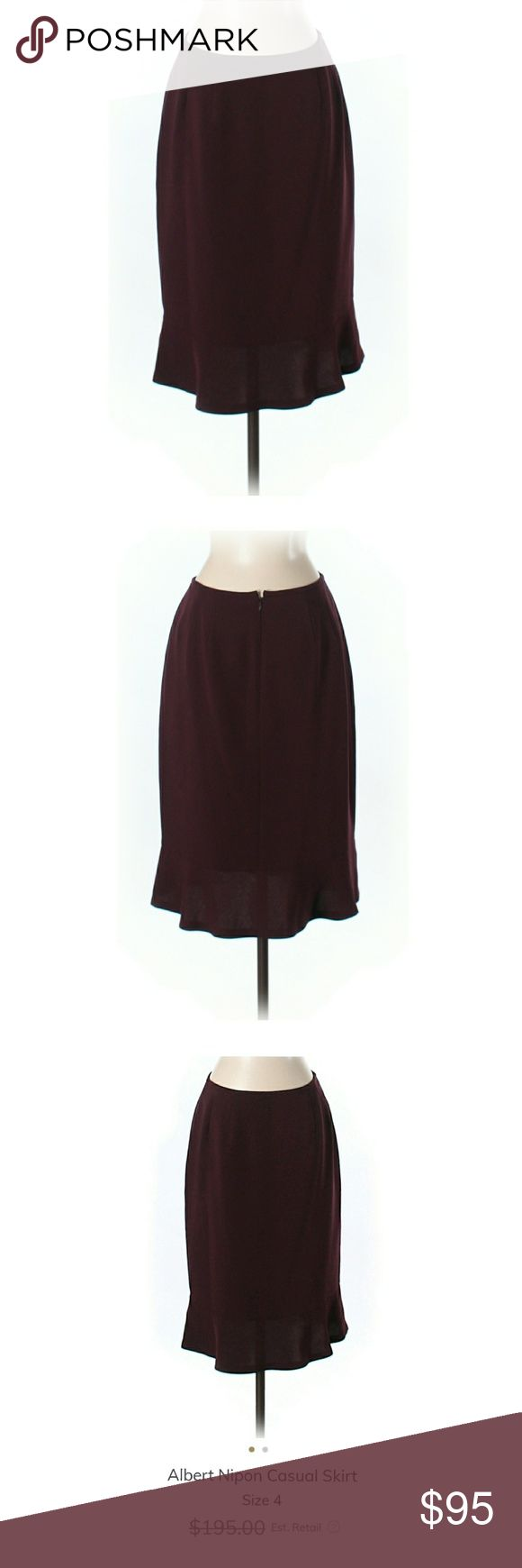"""NWOT Albert Nipon Pencil Skirt 71% Triacicetate, 29% Polyester. 23"""" Length. Beautiful dark burgundy color in lovely silhouette. It won't be available for me to ship until next week. I will PRICE DROP then, so *like* to be notified!       ***I'm lucky that my buyers have been nothing short of wonderful, but I video record all purchases before and during the packaging process to protect from scammers ☺ Albert Nipon Skirts Pencil"""