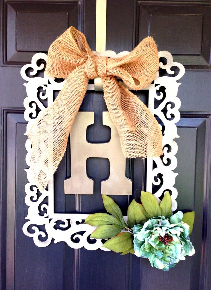 Framed door wreath... Thank you Michaels for the ingredients and inspiration!  (Wood frame, wood letter, spray paint, roll of burlap ribbon, flower, small ribbon and glue gun!)