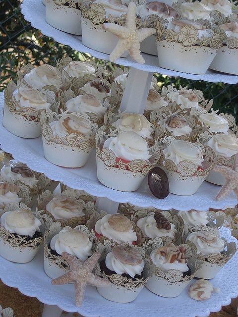 Beach theme wedding?.....this is the display for you!  You will even find the theme on the cupcake wrappers!  www.getcupcakepants.com