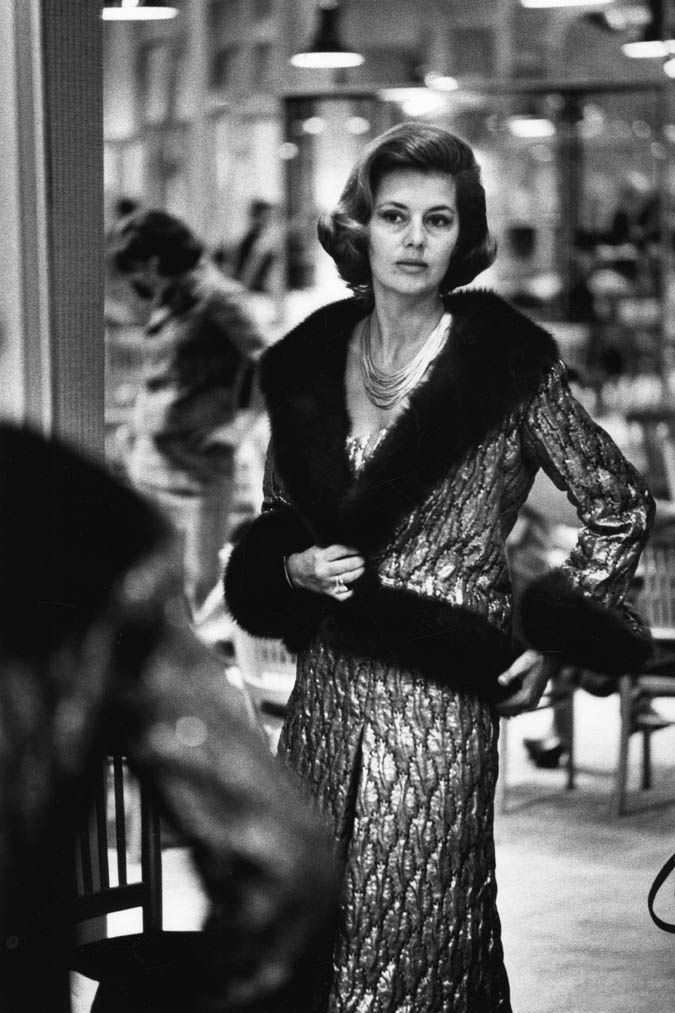 Cyd Charisse trying on ensemble at Chanel.