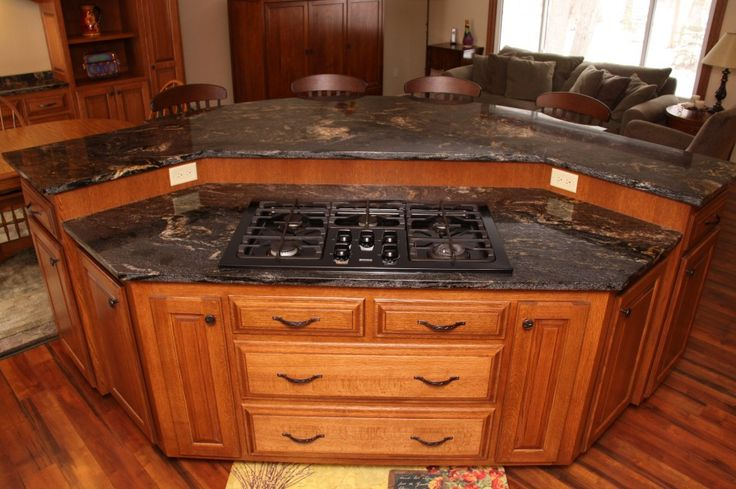 Kitchen, Solid Wood Kitchen Island With Fancy Dark Honed Granite Table Top And Modern Four Burner Gas Cooktop: 35 Terrific Kitchen Island Pictures Ideas