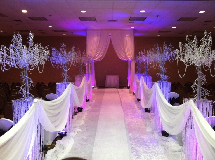 White Velvet Aisle Runner And Ice Crystal Trees Atom Pillar Columns