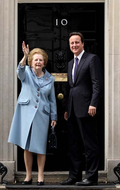 British Prime Minister David Cameron greets former Prime Minister Baroness Thatcher on the steps of Number 10 Downing Street on June 8, 2010