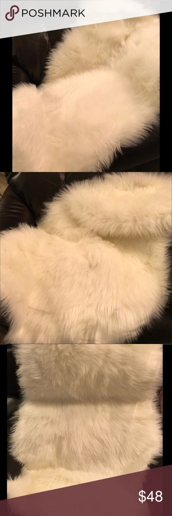 NWT - Beautiful Lambskin Rug - Quality Faux Fur. NWT - This high quality faux lambskin rug is especially nice for those 'Special' 1st time impressions. Beautiful draped on furniture, in front of your fireplace or laid at the foot of your bed. Beautiful. (It is also especially nice to have to photograph your posh items on too. It makes for a beautiful background for many items. 💞) Accessories