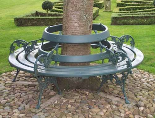 Circular shaped tree seat from lost art featuring blackberry design cast iron bench supports Circular tree bench