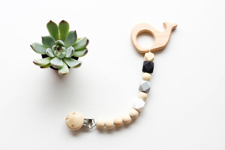 Silicone and Wooden Teether clip  Your little one will love the variance of sizes and styles of the beads being busy to grab and chew on the new best animal friend.  Silicone teether, Wooden Toy Clip, Soother Clip Wood and Black silicone beads