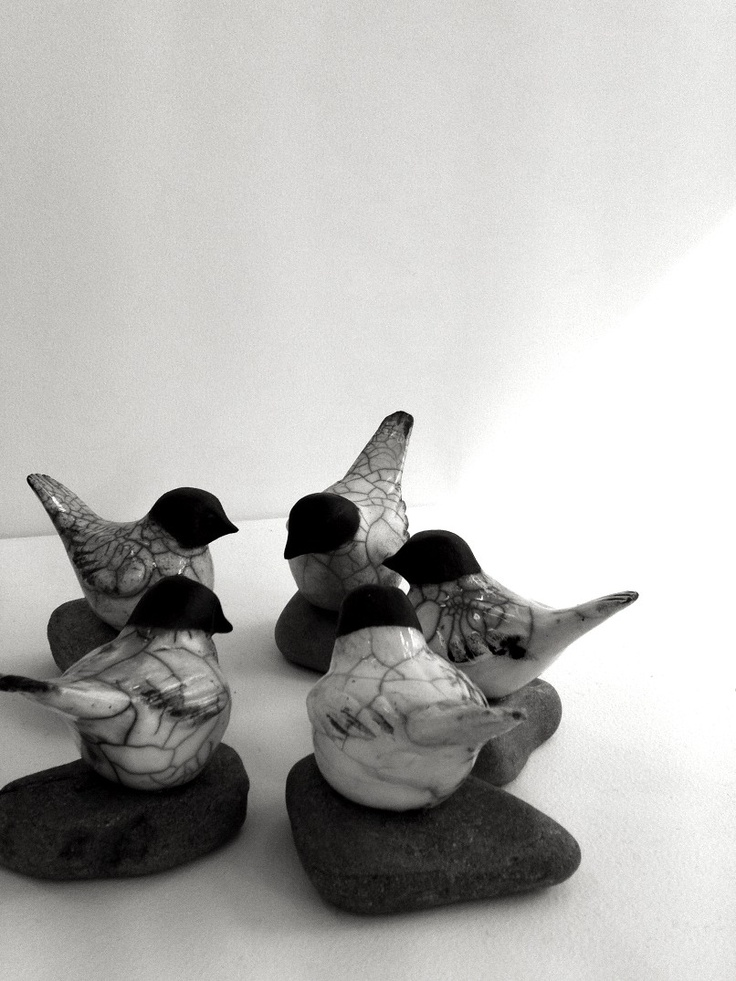 ceramic birdies....love these. Might have to try something along these lines