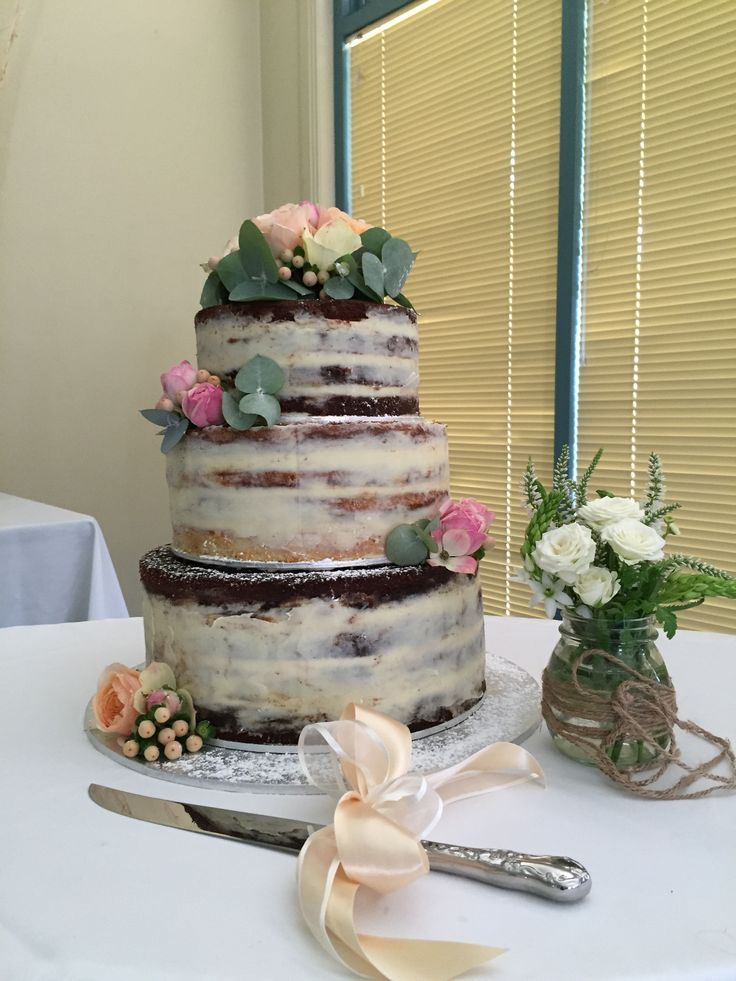 3 Tier Naked vintage wedding cake. Chocolate and vanilla cakes layered with raspberry coulis and white chocolate ganache.