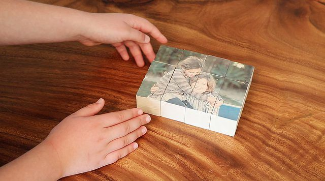An easy DIY for kids and grownups to make a personalized wooden block puzzle using your favorite photo.
