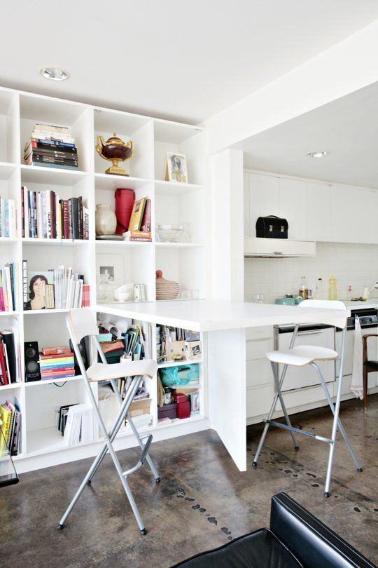 Murphy style table that folds down when not in use. How To Fit a Dining Room Into Small Spaces | Apartment Therapy