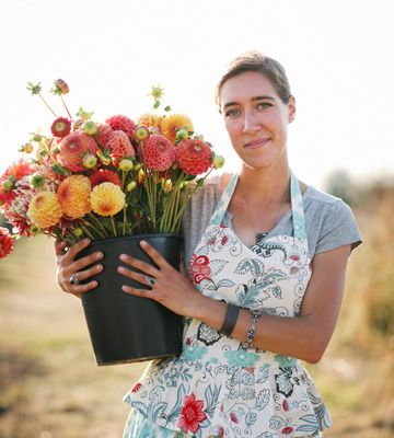 How to Grow a Cut Flower Garden: Erin Benzakein with bucket of flowers