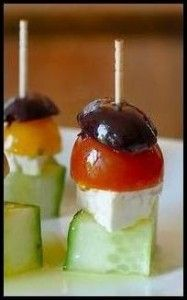 On each skewer, add one slick of cucumber, one cube of feta cheese, one grape tomato and top with one Kalamata olive. Once completed, align all skewers on a serving platter, drizzle with olive oil and sprinkle with oregano. Keep chilled until ready to serve.