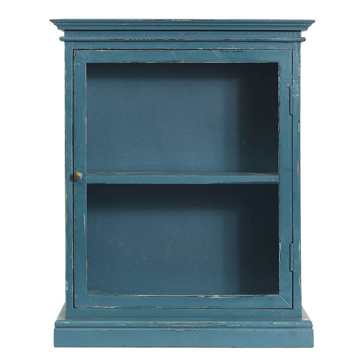 A delightful vintage-style wall cabinet.Available in pink, turquoise, teal and antique whiteThe cabinet features a glass hinged door which opens to reveal an internal shelf. The cabinet has a dark wooden base which has been handpainted then expertly distressed to achieve a lovely, aged finish. This cabinet will stand on its own, but comes inclusive of fittings for wall-mounting. It looks gorgeous displaying your lotions and potions in the bathroom or your spices or preserves in the kitchen…