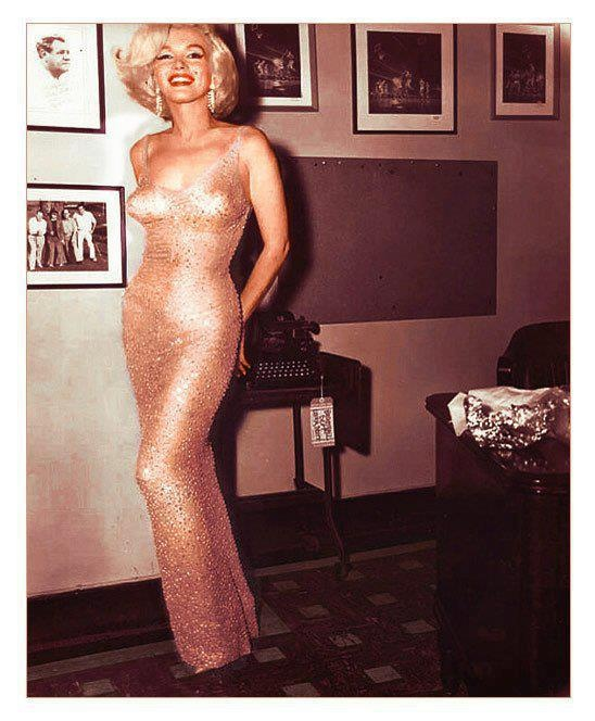 """Marilyn Monroe backstage at President John F. Kennedy's birthday gala at Madison Square Garden, NYC, 1962, minutes before singing """"Happy Birthday, Mr. President"""".Marilyn Monroe's legend has continued decades after her death. One of her most-iconic moments was singing """"Happy Birthday Mr. President"""" to John F. Kennedy on Saturday, May 19, 1962 at Madison Square Garden. The dress is on display in this July 26, 1999 photo at Christie's in New York. The sheath dress, in flesh-colored souffle…"""