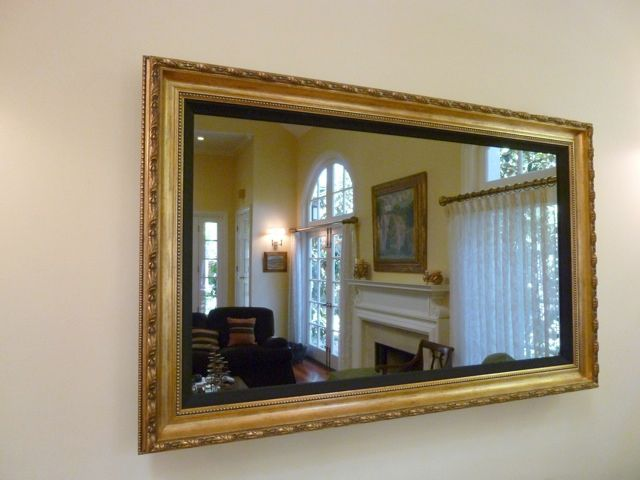 Framed TV/mirror.