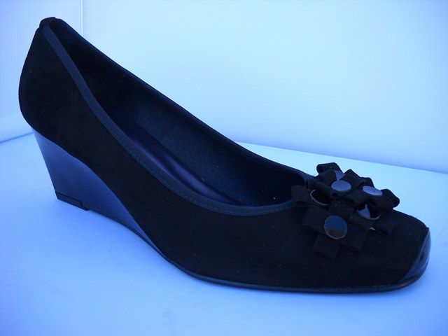 Brenda Zaro from Spain.  Suede court with flower detail available in black with tapered heel.    Sizes range 36-41.