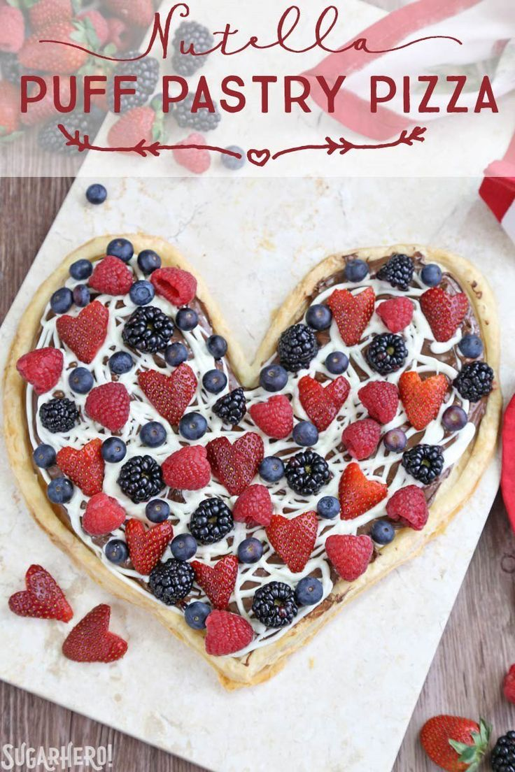 Nutella Puff Pastry Pizza is easy and delicious. You'll love the combination of buttery puff pastry, Nutella, white chocolate, and juicy fresh berries! | From SugarHero.com