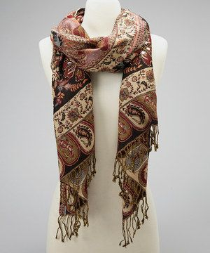 Draped as a shawl or wrapped warmly around necks, this versatile scarf brings sophistication and style to any outfit. A pretty paisley print adds perfect touch of class.