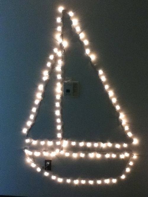 Sailboat made of holiday lights. How perfect would this be for pref?!