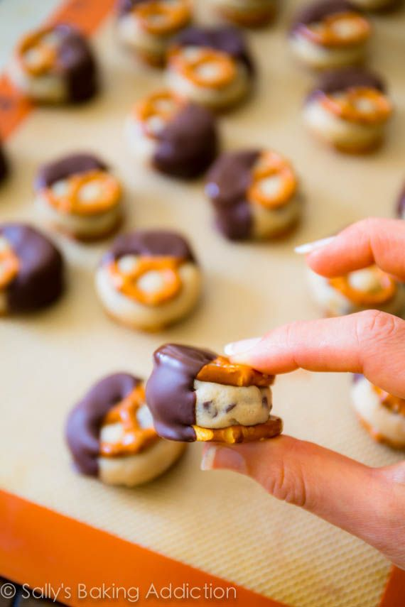 Cookie Dough Pretzel Bites. Safe-to-eat cookie dough stuffed between two salty pretzels. These bites are addicting! No-bake & take no time at all! Get the recipe at sallysbakingaddic...