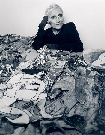 "In memoriam : Nancy Spero -- Portrait of the artist with her mounds of ""paper dolls."""