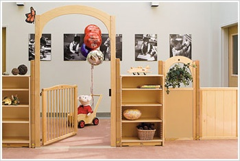I love how subtle this 'fence' and gate is. Doesn't give the 'jail' impression or 'play pen' impression like in the vast majority of prior to school settings.