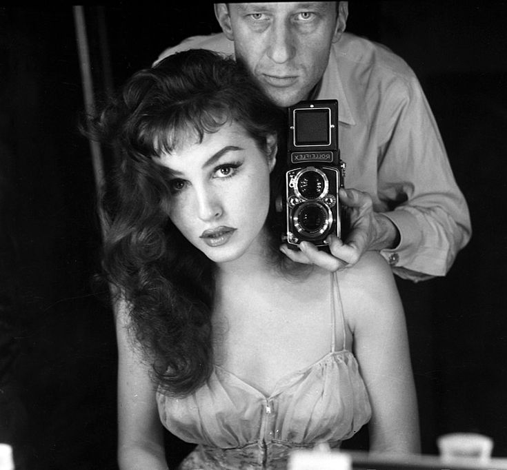 Julie Newmar and photographer, 1950s