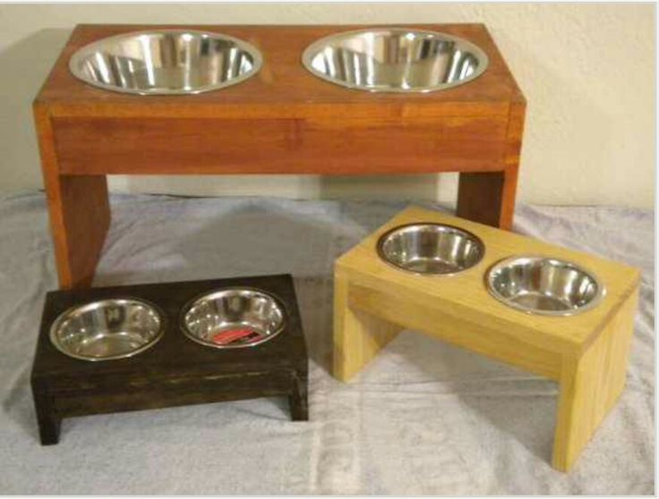 make each dog's bowl a different color and the set stackable. Raised dog food bowls. Dog dish /bowl stand