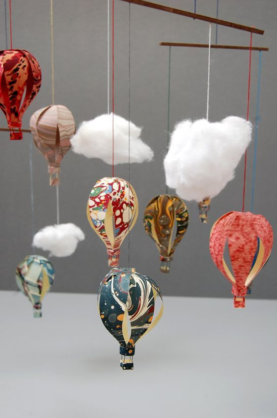 Love the swirling colors on this custom marbled paper hot air balloon mobile.: