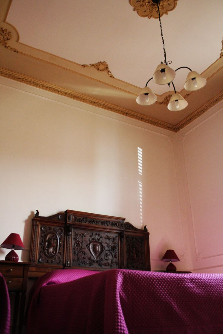 Tramontana Triple #Room balcony with lateral view of #Trapani port. The original adorned ceiling and the #sicilian wooden extremity of 19th century will bring you to refinement of olden times. www.bebtrapanilveliero.it/