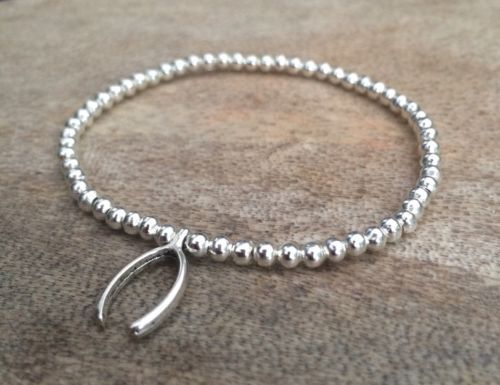 #Silver plated wishbone charm ball #beaded stretch bracelet, handmade, #surfer bo, View more on the LINK: http://www.zeppy.io/product/gb/2/272389064393/