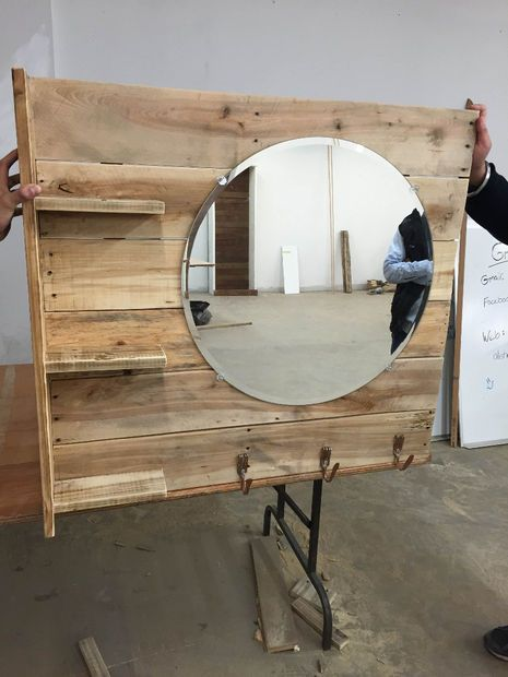 Pallet shelf and mirror - - maybe an entry way?  Add some wood slices around the mirror.......an idea