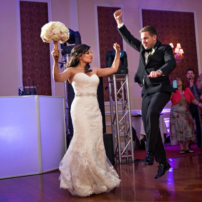 """""""We had all of our wedding party couples enter to hyped-up songs we picked out for them. They all got into it, and so did our parents! It set the party mood,"""" Rupal says."""